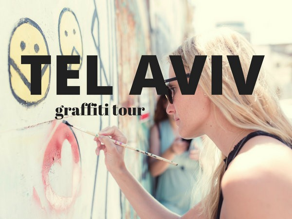 """You cannot miss the graffiti in Tel Aviv... that is, if you go to the cool areas! We did a tour with a local graffiti artist, which was a special tour thanks to the tourism board. Unfortunately, I don't think he typically does tours or lets people graffiti themselves, but if you're really keen, it can't hurt to ask him on his Instagram: @orenfischer. We hit up an art gallery first and got to understand what journalism is like in Israel. Every country is different in how they allow journalists/bloggers/news to have """"freedom of speech"""", some countries better than others. It was awesome to meet with some local writers who write about politics in their country and don't hold back. Graffiti in Tel Aviv After meeting in the gallery, we were off to see Oren's graffiti. He's actually really well-known in Tel Aviv (or at least his art is). Another well known guy has a tag which is a band-aid (tags are like graffiti artist signatures- you might know this but if my mom and dad are reading they probably didn't lol). See if you can find the band-aid below! Graffiti in Tel Aviv Graffiti in Tel Aviv Graffiti in Tel Aviv Graffiti in Tel AvivCouldn't resist having a photo taken with the graffiti background. It didn't hurt that we had a photographer traveling with us (Or Kaplan @oktlv) who did some awesome shots of all of us for our social media! Graffiti in Tel Aviv Graffiti in Tel AvivPS how cute is my new camera? It's the [easyazon_link identifier=""""B01JGMPM4G"""" locale=""""US"""" tag=""""Hipinhee-20""""]Panasonic GX80[/easyazon_link] and my photos from Israel were so much better than previous trips because of it. I never thought I'd want to carry a camera around, but now I can't believe I waited this long. Graffiti in Tel Aviv Graffiti in Tel Aviv Graffiti in Tel Aviv Graffiti in Tel Aviv Graffiti in Tel Aviv Graffiti in Tel AvivSo, we stopped for juices at this cafe which had seating in the back of a parked truck. I guess that makes it a truck stop! I'm not going to lie, I hated this drink. It"""