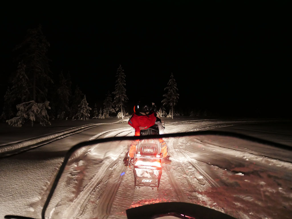 Searching for the Northen Lights on a Snow Mobile