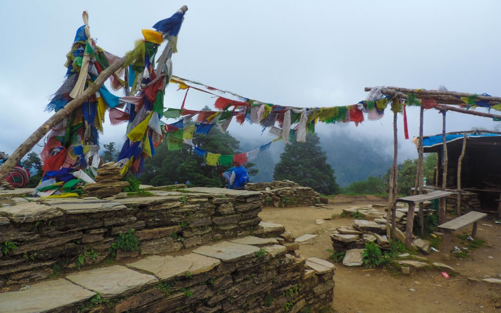Prayer flags over the moutain ridge, a common sight whilst trekking in Nepal