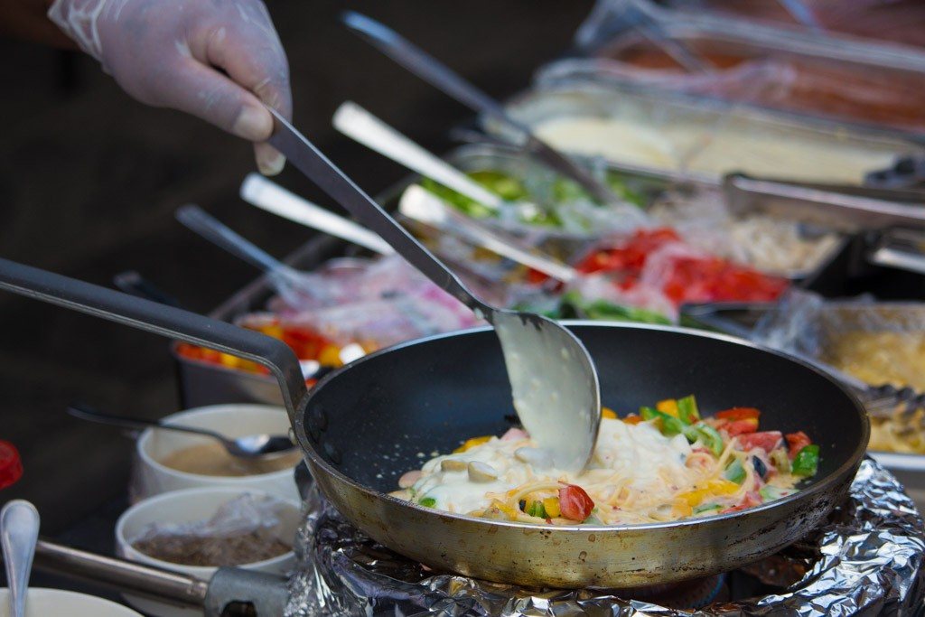 Some delicious food being prepared at the venue of the Himalayan Travel Mart